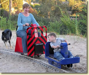 Child and Mother on Hand Crank Cars